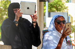 We Are All Unite Behind the Apple OR: In Apple We Trust (ybiberman) Tags: portrait apple sunglasses israel veil candid jerusalem streetphotography cellphone nun procession russian virginmary tablet churchoftheholysepulchre oldcity alquds ethiopian theotokos christianquarter