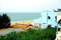 Popenguine (EmperorNorton47) Tags: ocean africa autumn houses fall film beach analog photo seaside outdoor overcast shore senegal noon vilage popenguine nikonn8008 agfavistaprecisa100