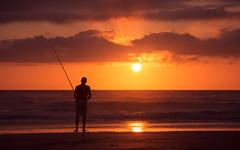 Fishing with the sunrise (diego__m) Tags: life sea summer vacation sun beach nature sunrise fishing fisherman waves seascapes joy motivation riograndedosul inspiring torres motivating