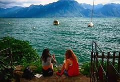 Enjoying Lake Geneva in Switzerland (` Toshio ') Tags: girls summer woman lake mountains alps water switzerland boat europe european waves sailing suisse swiss sailboats jazzfestival lakegeneva montreux lacleman toshio xe2 fujixe2