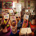 Kindergarteners raise hands for rare disease day