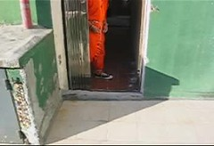 Prisoner walking in AHC L-200 (asiancuffs) Tags: sneakers prison converse shackles chucks handcuffs prisoner handcuffed connectingchain