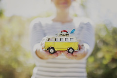 With freedom, books, flowers, and the moon, who could not be happy?   ~Oscar Wilde~ (Sandra H-K) Tags: sunlight bus cute sunshine yellow vw vintage toy outside miniature holding hands dof bokeh outdoor september depthoffield backlit vwbus toyphotography 35mm14 toybus canon70d miniaturemonday