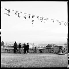These boots are not for walking (Michael Wgerbauer) Tags: city blackandwhite 6x6 film mediumformat shoe blackwhite cityscape prague noiretblanc prag praha czechrepublic schwarzweiss ilford filmgrain xtol yashicamat124g orangefilter letensksady yashicamat124 letn scannedfilm mittelformat yashica124g schwarzweis filmisnotdead canoscan8800f excelw27