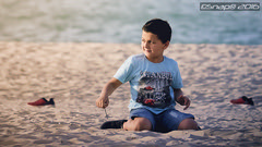 Boy at the beach (Snap) Tags: boy sunset sea portrait people beach water marina children child outdoor kuwait q8 salmiyah