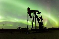 Oilpatch Light Show (Blue Trail Photography) Tags: light sky canada night jack lights grande north pump alberta aurora oil prairie patch northern oilfield borealis pumpjack oilpatch