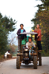 Tractor riders (MelindaChan ^..^) Tags: china guilin guangxi