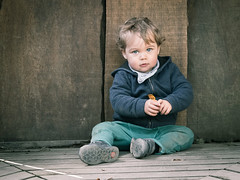 Bruno with Orange Spoon (Diggoar) Tags: family portrait children child availablelight telephoto q bruno pentaxq