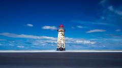 Talacre Lighthouse (Tim Furfie) Tags: ocean uk longexposure blue sea sky lighthouse beach water wales talacre