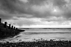 Cromer, Norfolk (canon fodder87) Tags: longexposure light sea england sky blackandwhite bw cloud seascape monochrome stone clouds canon dark landscape mono coast seaside outdoor norfolk shore 7d slowshutter cromer mkii leadinglines