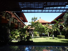 Sanur Paradise Plaza Hotel Courtyard (rishao262) Tags: trees bali plants water gardens architecture palms indonesia architecturaldetail courtyard pools sanur tileroofs epicadventure sanurparadiseplazahotel