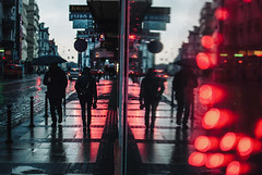 165/365 Red Carpet (ewitsoe) Tags: street winter urban woman man streets reflection window rain umbrella walking nikon poland sidewalk sw citycenter poznan redbokeh ewitsoe marcinstreet