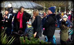 Town Hall Gardens (* RICHARD M (Over 5 million views)) Tags: street november childhood kids children waiting candid crowd families watching crowds southport streetfashion merseyside warmclothes sefton keepingwarm woolenhats woolyhats stayingwarm warmclothing wrappedupwarm bobblehats streetstyles southportchristmaslightsswitchon