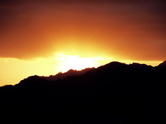 Valley of fire (Adobe Garamond) Tags: light red mountain sunrise landscape fire dawn rocks warm ray peace shine desert rocky silouette valley strong lonely rise godlight