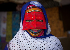 a bandari woman wearing a traditional mask called the burqa at panjshambe bazar thursday market, Hormozgan, Minab, Iran (Eric Lafforgue) Tags: red portrait people woman beauty horizontal outdoors persian clothing eyes asia veil mask iran muslim islam religion hijab culture persia headshot hidden covered iranian bazaar adults adultsonly oneperson traditionaldress burqa customs ethnicity middleeastern frontview sunni burka chador 20sadult youngadultwoman balouch hormozgan onewomanonly lookingatcamera burqua  bandari  embroidering 1people  iro thursdaymarket  minab colourpicture  borqe panjshambebazar boregheh iran034i2719
