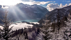 View on Lake Achen (and Brandenberg Alps) (VandenBerge Photography) Tags: travel winter sky mountains alps nature water clouds forest canon season landscape austria tirol europe valley lonelyplanet pinetrees tyrol sunbeams snowscape nationalgeographic achenkirch achensee christlum rofanrange lakeachen brandenbergalps achenvalley