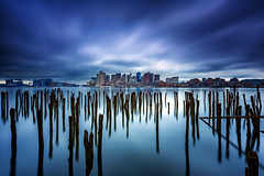 Lost Pier of Maverick Landing in East Boston with Decayed Pilings and Boston Skyline under Stormy Sky (Greg DuBois - Sponsored by LEE Filters) Tags: ocean old longexposure sea sky usa reflection water boston clouds canon reflections photography coast pier photo photographer waterfront unitedstates cloudy photos massachusetts stock shoreline newengland wideangle stormy wallart calm historic shore wharf reflective serene pilings waterblur pylons northeast decayed decaying eastcoast bostonskyline eastboston 6d bostonharbor northatlantic leefilters mavericklanding bigstopper gregdubois