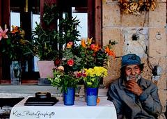 flowered old man! ( ) Tags: old flowers man classic vintage nikon europe traditional oldman greece crete tradition oldtime chania nikorr