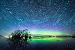 Sky full of stars (jarnasen) Tags: copyright lake tree green water night reflections stars nikon tripod wideangle aurora startrails nordlys norrsken roxen northernlight starwheel d810 nybro borelis startrailsexe nordiclandscape samyang14mmf28 astrolandscape jarnasen wwwfacebookcomjarnasenphotography