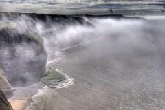 Rolled together (pauldunn52) Tags: sea sun mist heritage wales temple bay coast cliffs glamorgan