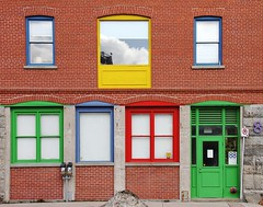 Colourful Trim (Karen_Chappell) Tags: door city blue windows red urban brown canada reflection building brick green window yellow newfoundland reflections downtown stjohns waterstreet nfld