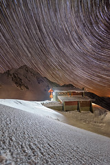 Nothing sits.. everything moves... (George Pancescu) Tags: nightphotography winter sky snow cold nature night stars landscape nikon scenery europe nightscape natural outdoor peak romania chalet nightscene startrails winterscape massif fagaras balea 1635mm d810 salvamont