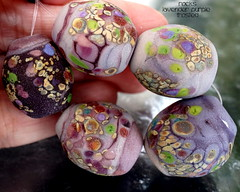 Rocks Lavender Purple Frosted (Laura Blanck Openstudio) Tags: show etched usa abstract green art glass leaves festival set beads rocks colorful published artist glow purple handmade stones eggplant burgundy maroon fine arts chartreuse violet fuchsia lavender plum funky pebbles made odd lilac earthy faceted winner mauve opaque bead organic transparent wearable kiwi nuggets murano lampwork beaded multicolor raku artisan matte whimsical loose frosted frit openstudio asymmetric ocher tumbled openstudiobeads