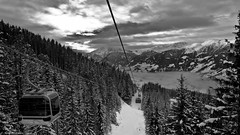 On The Wire (Neil. Moralee) Tags: sky blackandwhite bw cloud white mist mountain snow black ski cold car pine landscape lumix mono austria high wire lift view neil down cable panasonic valley land fir gondola slope zell ziller lx7 traa moralee neilmoralee