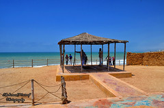 Tushan Beach, Karachi (Shehzaad Maroof Khan) Tags: life blue pakistan sea sky green beach water rock seaside nikon hut karachi chill sindh