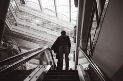 Escalate (Asher Isbrucker) Tags: up silhouette stairs person climb vanishingpoint movement stair pov escalator move pointofview complex