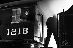 Feeding the Beast (Drifton) Tags: railroad blackandwhite bw white black art monochrome train virginia nw power norfolk engine rail railway trains steam crew roanoke va western rails fireman backlit coal railways 1218 vmt