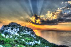 There is always light (NikosPesma) Tags: sunset sea sky sun lighthouse clouds landscape rocks view outdoor corinth aegean greece sunrays hera  loutraki heraion     gulfofcorinth