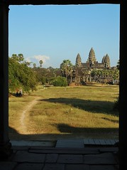 the path to Angkor Wat (SM Tham) Tags: trees sky monument grass stone architecture landscape temple cambodia khmer shadows path towers buddhism angkorwat unescoworldheritagesite doorway angkor grounds flagstones suryavarmanii