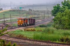 BNSF551 Rain (bschwenk photography) Tags: railroad b green cars grass rain train switch track railway bn caboose rainstorm rockymountains trainengine bnsf traincars broomfield railroadtrack broomfieldcolorado i36 b408w mp15 centerbeam bncaboose i36colorado