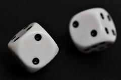 Rolling dice [Explored] (tounesse) Tags: two blackandwhite bw dice macro noiretblanc explore dices deux lowkey hmm due d ds 105mm d90 explored sb900 macromondays
