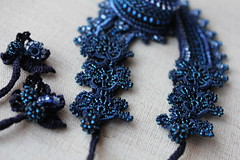 Blue collar lace necklace with beaded crochet flowers in cobalt blue and sapphire blue tones by irregular expressions (irregular expressions) Tags: cobaltblue beaded sapphireblue bluegray beadednecklace indigoblue crochetflower beadedflower crochetnecklace bluenecklace beadedcrochet collarnecklace lacenecklace beadedlace irregularexpressions statementnecklace beadworknecklace bluelacenecklace beadworklace