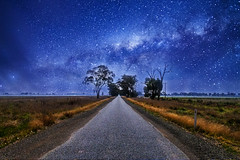 Road to Milky Way (Indigo Skies Photography) Tags: road street pink flowers blue trees light red sky orange white black cold flower color tree green art nature water field yellow night clouds stars landscape photography flickr farm space wideangle galaxy universe milkyway paddocks nikond7000