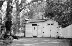 Old School (F. Neil S.) Tags: film monochrome 35mm bench drive blackwhite garage northcarolina 11 negative pitchfork oaks piedmont smalltown lawnchair xtol blancetnoir nikonf5 arista selfdev springafternoon eduultra200