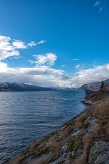 Fjord under blue sky (imagesbystefan.com) Tags: ocean travel blue sea wild vacation sky white lake mountains nature water beautiful norway clouds landscape coast spring scenery view natural scenic nobody scene line hills norwegian explore fjord serene wilderness idyllic sognefjord