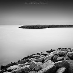 Time Stands Still (azrudin) Tags: light sunset sea sky sun monochrome silhouette stone square landscape blackwhite still lowlight slow fineart filter squareformat slowshutter scapes longexposures fishermanvillage graduatedfilter azrudinphotography