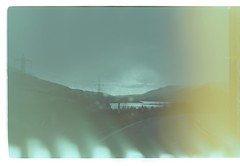 (Linden Kingston) Tags: road lake black colour art film walking landscape experimental driving power hill holes negative cables processing exposed resevoir sprocket hydroelectric