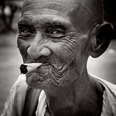 _MG_2182 Old Smoker (otaphoto1) Tags: bw man eye face countryside cambodia village cigarette character oldman newyear age smoker canon70d