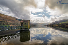 Reflecting on a Cloudy Day (Gavmonster) Tags: road blue trees sky white lake mountains nature water beautiful stone wales architecture clouds reflections landscape grey nationalpark nikon scenery view outdoor wideangle reservoir breconbeacons hills attractive land waterworks talybont polarisingfilter valvetower 1024mm d7000 talybontonuskreservoir nikond7000 gswphotography