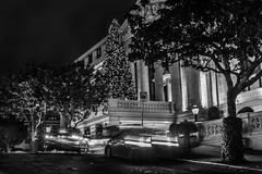 taking a taxi to the ritz (pbo31) Tags: sanfrancisco california christmas party blackandwhite black silhouette architecture night dark season hotel nikon holidays december display taxi christmastree structure motionblur ritz ritzcarlton nobhill valet 2015 metropolitian lightstream boury pbo31 d810
