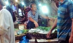 The Fishmonger (RiddhoRaju) Tags: portrait fish shop market bongo progress business fishmarket bengal bangladesh bangla prosperity bengali shopkeeper htc bangladeshi bangali fishseller jessore anawesomeshot thefishmonger photoghrapy fishphotography catchthedream fishbusiness jessorebangladesh rajudey riddhoraju  fishmarketjessore jessorekhulnabangladesh   riddhorajuphotography