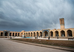 ganjali khan square, Central County, Kerman, Iran (Eric Lafforgue) Tags: city travel people urban building tower tourism horizontal architecture outdoors photography persian asia day desert iran traditional towers middleeast culture persia arches bluesky architectural catcher orient groupofpeople kerman cultural middleeastern windcatcher windtower badgir coolingsystem  buildingexterior fulllenght  5people  iro  builtstructure unrecognizableperson ganjalikhan centralcounty colourpicture ganjalikhancomplex  irandsc07017