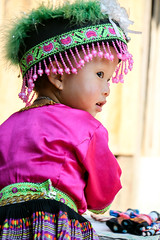Girl in ethnic costume, Hmong village near Luang Prabang, Laos (inchiki tour) Tags: travel portrait people girl photo asia southeastasia village embroidery traditional cloth laos ethnic luangprabang hmong stitchwork   louangphrabang
