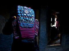 woman wearing beautiful zanskar traditional dress inside Her mud house (magbrinik) Tags: colors colorful tibet zanskar ladakh traditionaldress backview headdress headwear perak travelphotography littletibet indiaimages tibetanculture tibetanfestival traditionalhome tribaljewellery ladakhlandscape flickrtravel abititradizionali traditionaljewellery karshamonastery tibetanreligion