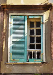 Blue Shutter (KaDeWeGirl) Tags: blue light shadow window french missing louisiana neworleans neglected shutters quarter disrepair