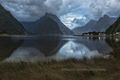 Stormy Dawn III, Milford Sound (chasingthelight10) Tags: travel newzealand storm mountains nature rain sunrise photography landscapes countryside waterfall seascapes events places things milfordsound fjords stormclouds mitrepeak